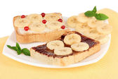 Delicious toast with bananas on plate close-up — Stock Photo