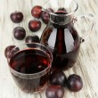 Delicious plum juice on table close-up — Stock Photo #32934415