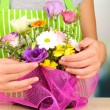 Florist makes flowers bouquet — Stock Photo #32935481