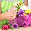 Florist makes flowers bouquet — Stock Photo #32935557