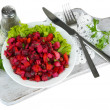 Beet salad on plate on napkin on wooden board isolated on white — Stock Photo #32936223