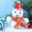 Beautiful snowman and Christmas decor, on blue background — Stock Photo