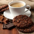 Cup of tasty coffee with tasty cookies, on wooden background — Stock Photo #33012715