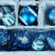 Christmas toys in wooden box close-up — Stockfoto