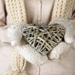 Female hands with wicker heart, close-up — Stock Photo #33016081