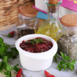 Stock Photo: Raw liver in bowl with spices and condiments on wooden table close-up
