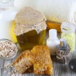 Honey and milk spa with oils and honey on wooden table close-up — Stock Photo #33018203