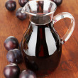 Delicious plum juice on table close-up — Stock Photo #33018327