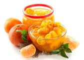 Orange jam with zest and tangerines, isolated on white — Stock Photo