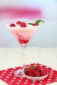 Raspberry milk dessert in cocktail glass, on light background — Stock Photo
