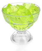 Tasty jelly cubes in bowl isolated on white — Stock Photo