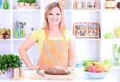 Happy smiling woman in kitchen preparing for healthy meal — Stock Photo