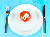 Calorie content of tomato on plate on wooden table close-up — Stock Photo