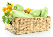 Raw yellow and green zucchini in wicker crate, isolated on white — 图库照片