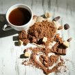 Cocoa powder in cup on wooden table — Stock Photo