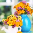 Bouquets of marigold flowers on wooden table on window background — Stock Photo #33083995