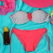 Swimsuit and beach items on bright blue background — Stock Photo #33084885