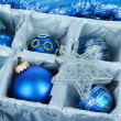 Christmas toys in wooden box close-up — Stock Photo #33085395