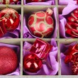 Christmas toys in wooden box close-up — Stock Photo #33085471