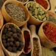 Many different spices and fragrant herbs close-up background — Stock Photo