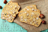 Biscotti with hazelnuts, on wooden background — Stock Photo