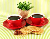 Red cups of strong coffee waffles on striped background — Stock Photo