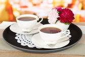 Cups of tea on tray on table in cafe — Stok fotoğraf