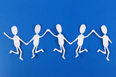 Paper people in social network concept on blue background — Stock fotografie