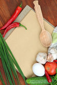 Cooking concept. Groceries with empty cookbook close up — Foto Stock