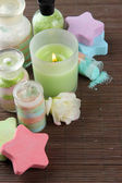 Composition with Aromatic salts in glass bottles and candle, on bamboo mat background — Stock Photo