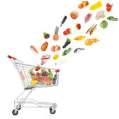 Food products flying out of shopping cart isolated on white — Stock Photo