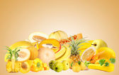 Collection of fruits and vegetables on beige background — Stock Photo