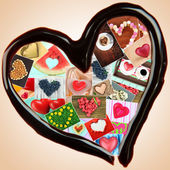 Collage of heart-shaped things in chocolate heart on beige background — Stock Photo