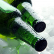 Bottles of beer with ice cubes, close up — Stock Photo