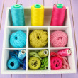 Multicolored skeins of thread in wooden box closeup — Stock Photo
