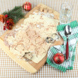 Making Christmas cookies on wooden board on tablecloth background — Foto de Stock