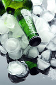 Bottle of beer with ice cubes, close up — Stock Photo