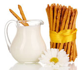 Tasty crispy sticks with pitcher with sour cream isolated on white — Stock Photo