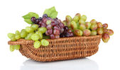 Fresh grape in wicker basket, isolated on white — 图库照片