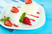 Delicious coconut cakes on plate on table close-up — Stock Photo