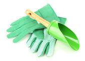 Kleine tuinieren schop en handschoenen geïsoleerd op wit — Stockfoto
