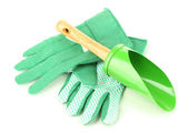 Små trädgårdsarbete spade och handskar isolerad på vit — Stockfoto