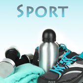 Different tools for sport on blue background — Stok fotoğraf