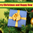 Gift on Christmas tree on green background — 图库照片
