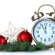 Alarm clock with Christmas decorations isolated on white — Stock Photo