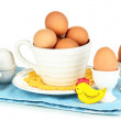Eggs in different crockery isolated on white — Stock Photo