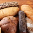 Much bread on wooden board — Stock Photo #33188747