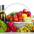 Composition with vegetables and fruits in wicker basket isolated on white — Stock Photo #33189477