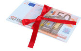 Euro with gift bow isolated on white — Stock Photo