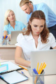 Office staff is during work in workplace — Стоковое фото